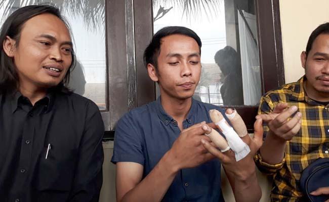 Bakti Rizal Hidayat SH, saat menemani Adit di Polres Malang Kota beberapa waktu beberapa waktu lalu. (gie)