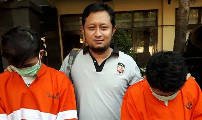 Tersangka Akbar dan Muhyidin saat berada di Polres Malang Kota. (gie)